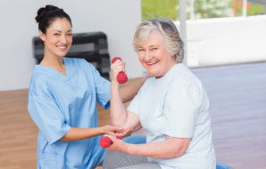 caregiver assisting senior woman with walker