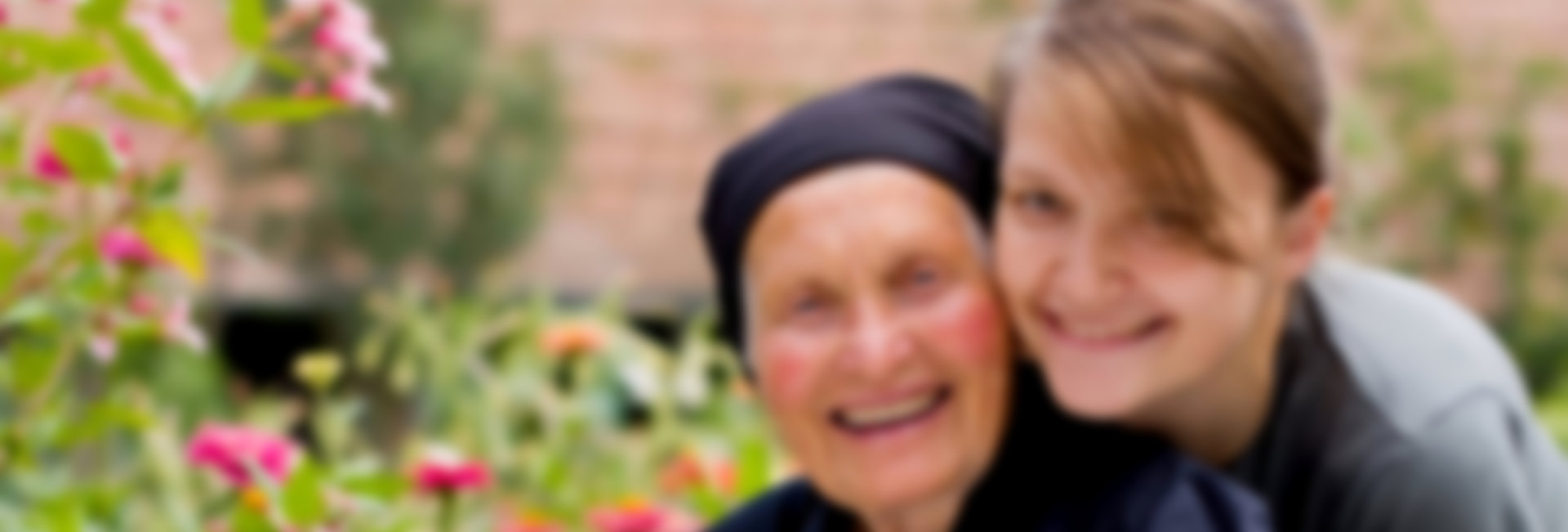 Caregiver is smiling together with her patient