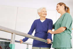 Old woman on exercise therapy in nursing home